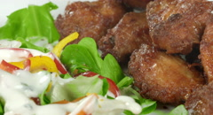 A 4K shot of a fresh salad plate with chicken wings moving in a circle. Stock Footage
