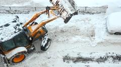 Backhoe loader make reverse turn after snow unload. Tractor move backward Stock Footage