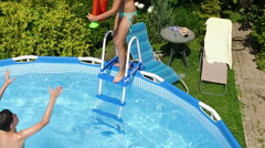 Weekend. Swimming pool. Children playing in the pool. Slow motion. HD - stock footage