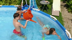 Weekend. Swimming pool. Children playing in the pool. Slow motion. HD Stock Footage