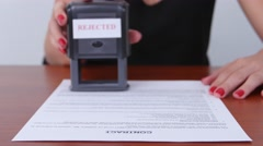 Woman puts print stamp on document. Close up Stock Footage