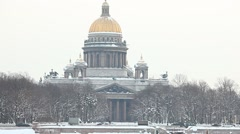 View of St. Isaac's Cathedral from opposite bank of Neva river, winter daytime Stock Footage