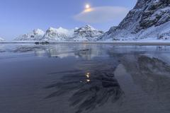 Full moon reflected in the icy sea around the surreal Skagsanden beach, Stock Photos