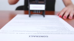 Business-woman puts a rectangular stamp of the company on the document. Close up Stock Footage