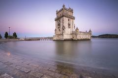 Colorful dusk on the Tower of Belem, UNESCO World Heritage Site, reflected in Stock Photos