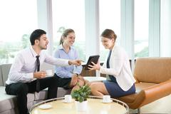 Business Team Informal Meeting in Office - stock photo