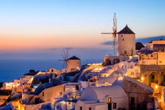Windmill and traditional houses, Oia, Santorini (Thira), Cyclades Islands, Greek Stock Photos