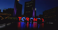 Nathan Phillips Square in Downtown Toronto at night Stock Footage