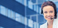 helpline operator in headset over business center - stock photo