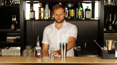 Barman pouring contents of jigger and pours in shaker prepares alcoholic Stock Footage