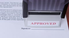 Girl approves a document for collaboration and puts a stamp. Close up Stock Footage