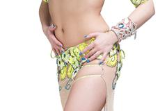Young beautiful exotic eastern women performs belly dance in ethnic  Stock Photos