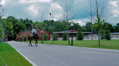 The man ride on the horse on the road Stock Footage