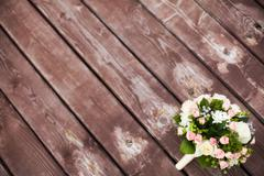 Beautiful wedding bouquet on vintage wooden background. Marriage concept Stock Photos