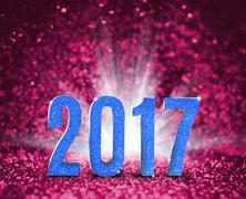 2017 new year with blue glitter texture with white explore light on pink spar - stock illustration