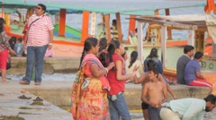 Mother braid hair of daughter on ghat,Maheshwar,India Stock Footage
