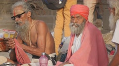 Sadhus smoking on ghat,Maheshwar,India Stock Footage