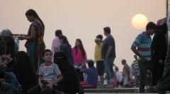 Pilgrims on ghats at sunset,Maheshwar,India Stock Footage