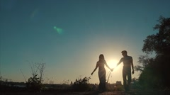 Young happy couple walking smiling holding around each other. Love story Stock Footage