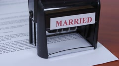 People seals the document of marriage by a rectangular seal. Close up Stock Footage
