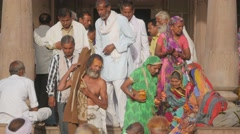 Pilgrims leaving temple after ceremony,Maheshwar,India Stock Footage
