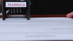 Person stamps the document of marriage by a rectangular seal. Close up Stock Footage