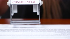 Person is responsible for the rectangular stamp. Close up Stock Footage