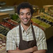 Portrait of Grocery clerk working in supermarket store Stock Photos