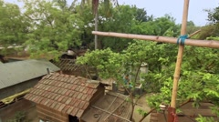 Traditional village in Bengal, India. Wide shot. Tilt and pan Stock Footage