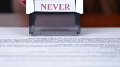 Employee puts at the bottom of the rectangular document printing. Close up Stock Footage