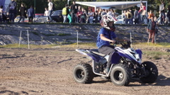 Riding quad bike in the park Stock Footage