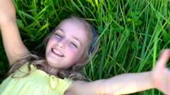 Cute girl on grass Stock Footage