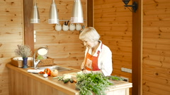 Husband takes his wife's knife and slices carrots. Stock Footage