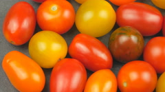 Camera pans across assorted cherry tomatoes Stock Footage