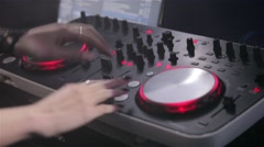 DJ plays on the remote in a nightclub. Close-up of DJ Console Stock Footage