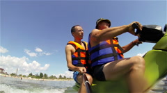 Henichesk, Ukraine - Two men having fun on the water scooter on the sea Stock Footage