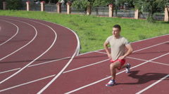 Athletic man exercising outdoors Stock Footage