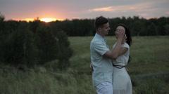 Guy hugs girl. Love. Sunset. Field Stock Footage