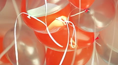 Close-up view of bright orange, silver and white balloons Stock Footage