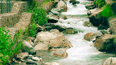 Shallow mountain river with artificial cascades made of rocks Stock Footage