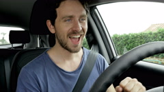 Cool happy man singing in car while driving 4K Stock Footage