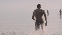 Athletic Black Male Running Into Lake Splashing Slowmotion Stock Footage