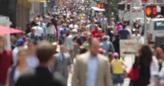 Crowd of commuter people walking street sidewalk Stock Footage