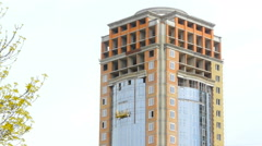 Facade of high-rise buildings under construction Stock Footage