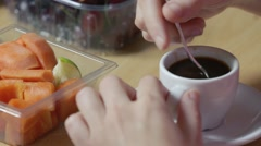 Girl mixing espresso coffee during breakfast Stock Footage