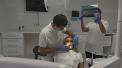 Dentist cabitet during the procedures. Dental specialist making inspection for Stock Footage