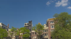 Tall elegant black and brown famous characteristic traditional canal houses - stock footage