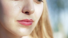 Close up shoot of lips young beautiful girl - stock footage