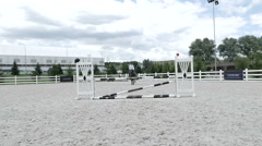 The horse is clings the barrier during the jump Stock Footage