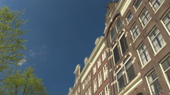 CLOSE UP: Stunning red brick old canal houses and their typical architecture Stock Footage